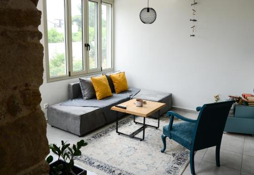 A seating area at Deus Apartments_ Athens Airport