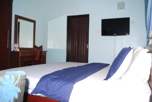 A bed or beds in a room at Koraf Hotels
