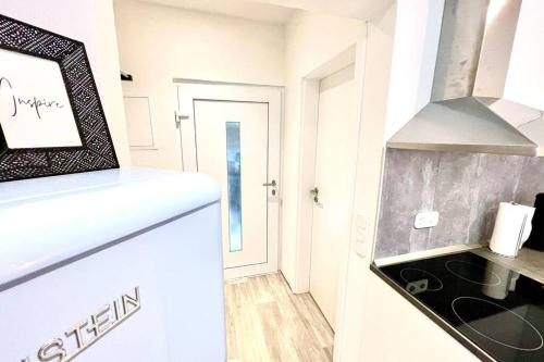 A kitchen or kitchenette at Tiny House inkl. NETFLIX in Duisburg