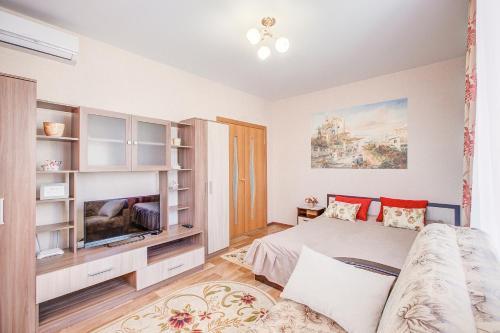 Кровать или кровати в номере Апартаменты на Ленинском проспекте 124 Б