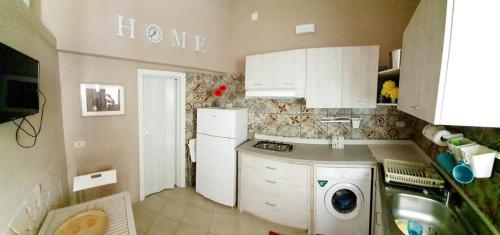 O bucătărie sau chicinetă la Appartamento soppalcato