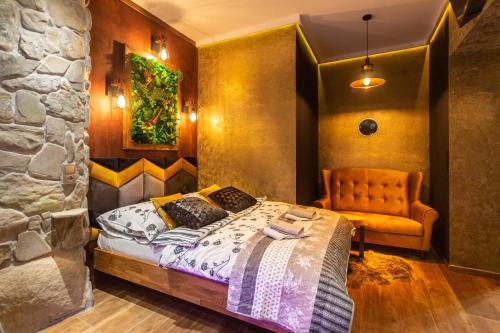 Łóżko lub łóżka w pokoju w obiekcie Willa Przy Dolinie Kościeliskiej