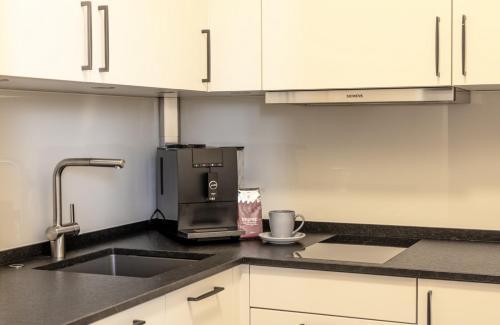 Küche/Küchenzeile in der Unterkunft Hotel KonradP Holzkirchen