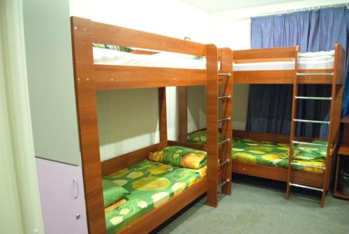 A bunk bed or bunk beds in a room at Sweet Hostel