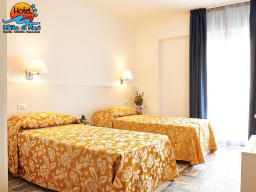A bed or beds in a room at Hotel Muita di Mari