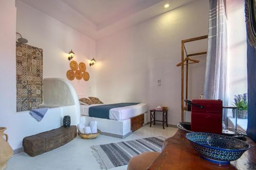 Un ou plusieurs lits dans un hébergement de l'établissement Mascot Garden Rooms