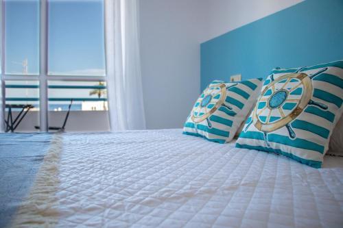 Cama o camas de una habitación en Hostal El Palmeral