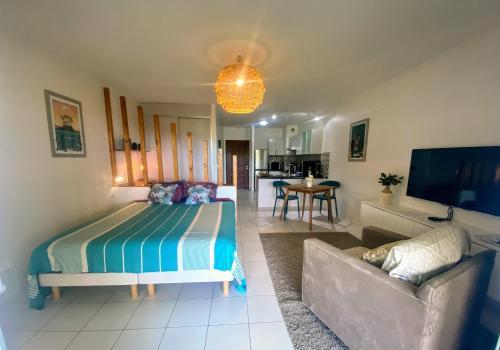 Uma área de estar em Grand Studio Les Horizons Papeete