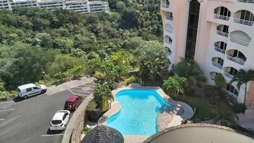 Uma vista da piscina em Grand Studio Les Horizons Papeete ou nos arredores