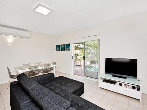 A seating area at Beachcomber Unit 4,- Beachside Unit -