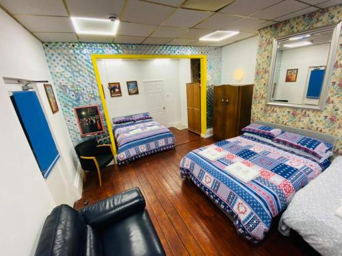 A bed or beds in a room at McHalls Hotel