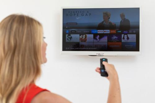 A television and/or entertainment center at SmartRoom Barcelona
