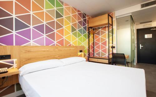 Letto o letti in una camera di Vértice Roomspace