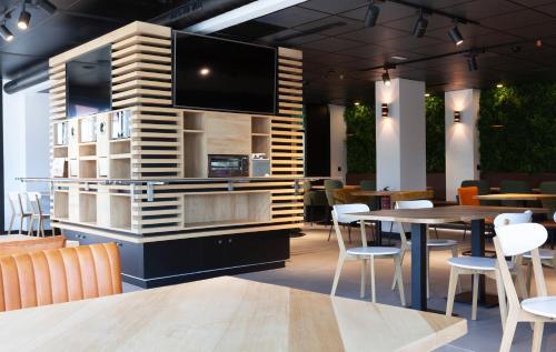 TV o dispositivi per l'intrattenimento presso Vértice Roomspace