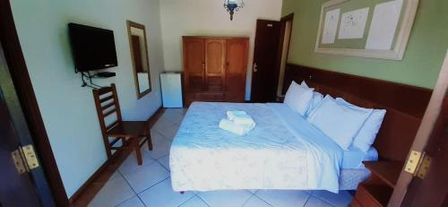 A bed or beds in a room at Hotel Casa Encantada
