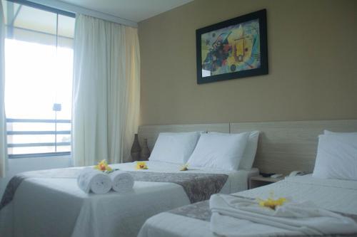 A bed or beds in a room at Pousada Ponta de Mangue