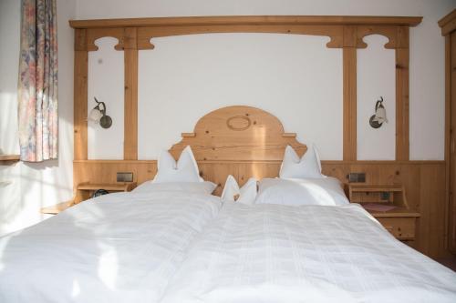 Ein Bett oder Betten in einem Zimmer der Unterkunft Haus Feichtner