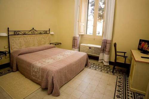 Ein Bett oder Betten in einem Zimmer der Unterkunft Hotel Villa Gli Asfodeli