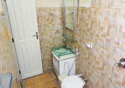Um banheiro em Pousada Casa Madrid