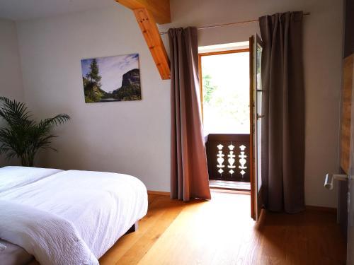 Ferienwohnung Bergfeelingにあるベッド