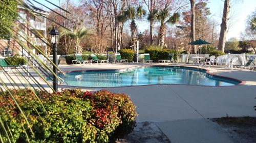 The swimming pool at or near ARROWHEAD AT RIVERWALK-Golf, close to beaches. LOCATION!