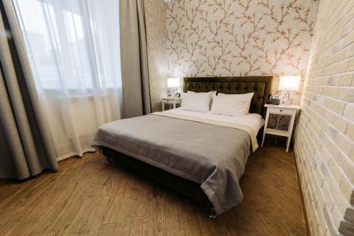 Кровать или кровати в номере City Hotel