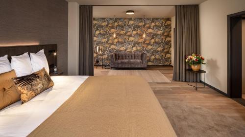 Een bed of bedden in een kamer bij Hotel Britannia