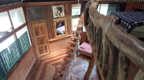 A bunk bed or bunk beds in a room at Utopia Eco Hotel