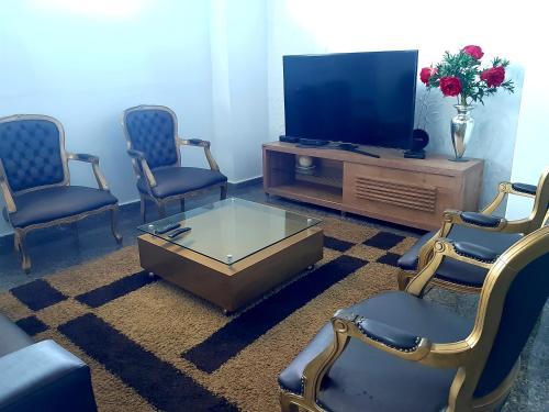 Uma área de estar em Carvalho's Hotel