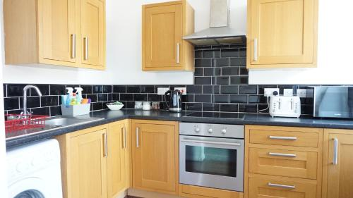 A kitchen or kitchenette at Sienna Family Holiday Apartments