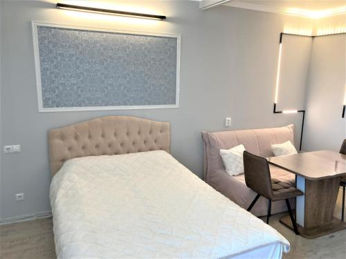 Кровать или кровати в номере Apartment Siyanie Sochi