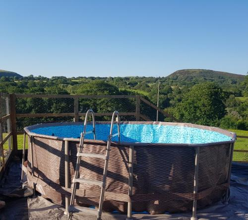 """The swimming pool at or near Brynheulog""""Sunshine Hill"""" Country Cottage, Craig Cefn Parc, SA6 5RH"""