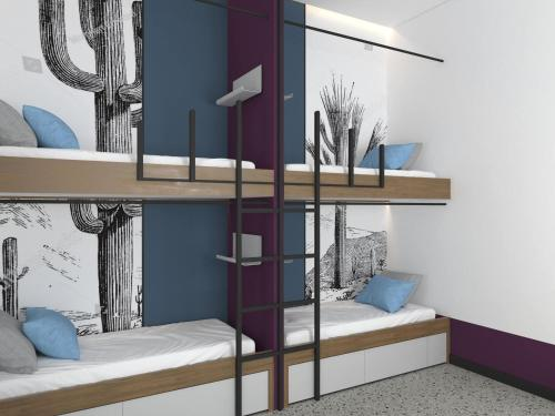A bunk bed or bunk beds in a room at Cocoon City Hostel