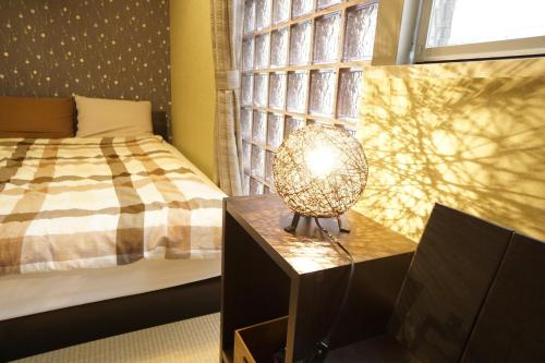 A bed or beds in a room at Riviere Dotonbori - Vacation STAY 8022