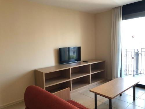 Een TV en/of entertainmentcenter bij Apartaments Trimar