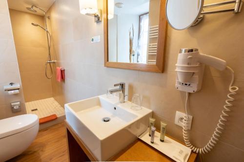 Salle de bains dans l'établissement Hotel à l'Oriel