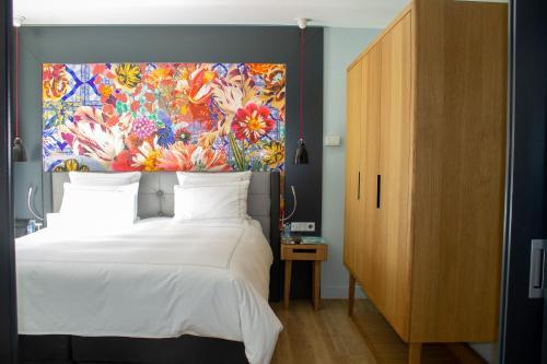 Un ou plusieurs lits dans un hébergement de l'établissement Swissôtel Amsterdam