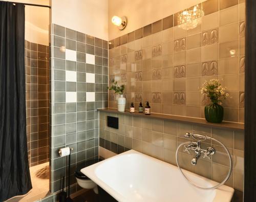 A bathroom at Cora Apartments