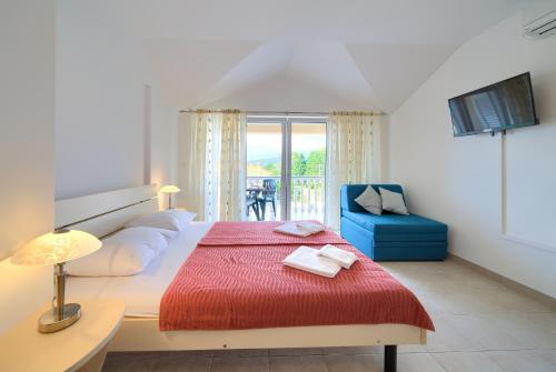 Posteľ alebo postele v izbe v ubytovaní Apartments Ivica Krk Island