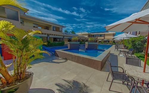 The swimming pool at or near Safira Praia Hotel