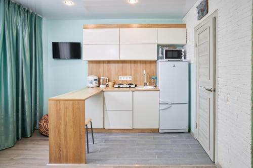 A kitchen or kitchenette at Квартира студия