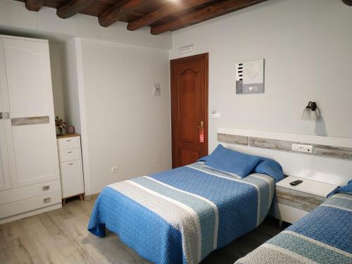 A bed or beds in a room at El Pinar