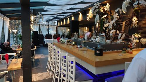 A restaurant or other place to eat at All Seasons Residence Hotel