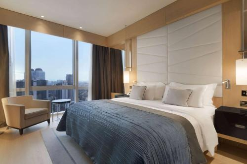 A bed or beds in a room at Wyndham Grand Istanbul Levent