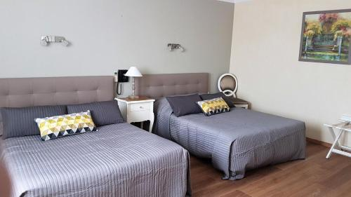 Un ou plusieurs lits dans un hébergement de l'établissement Le Castelet des Alpilles