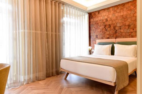 Cama o camas de una habitación en My Story Hotel Tejo
