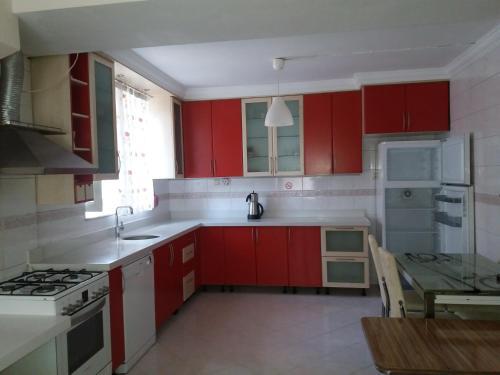 A kitchen or kitchenette at Camlik Apart Hotel