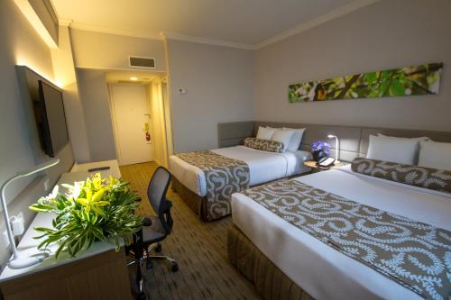 A bed or beds in a room at Crowne Plaza Managua, an IHG Hotel