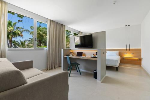 A television and/or entertainment center at Hotel Areca