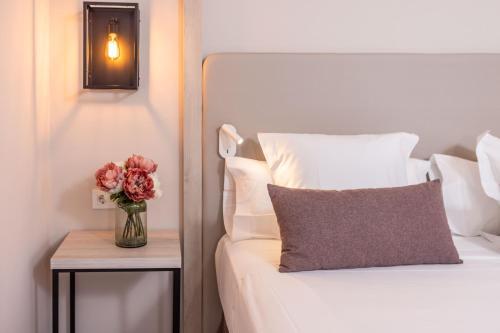 Cama o camas de una habitación en RVHotels Balneari Broquetas